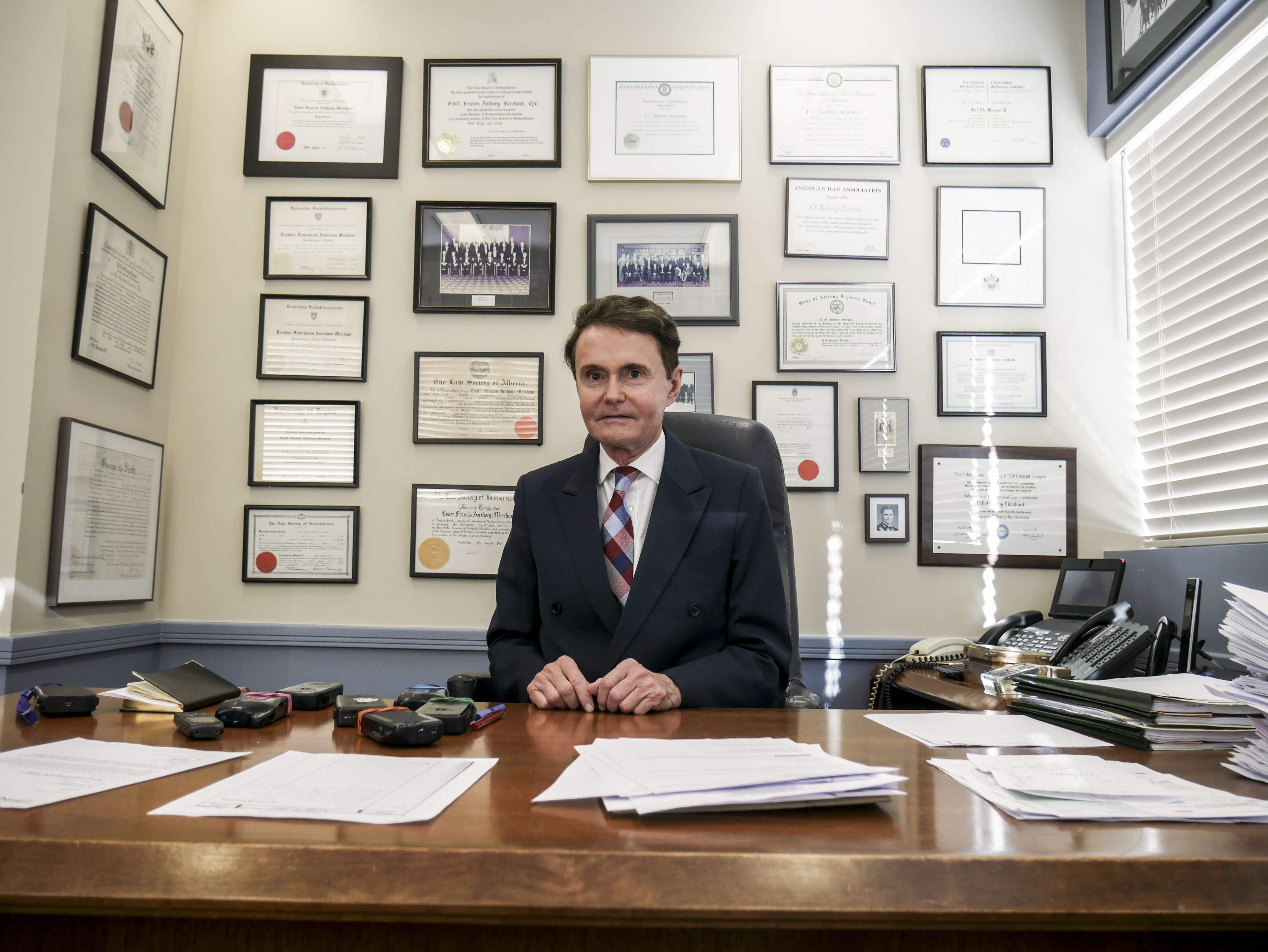 Tony Merchant sits at his desk in the Regina based branch of the Merchant Law Group LLP. From his desk he manages his national legal empire. Photo by Josh Diaz.