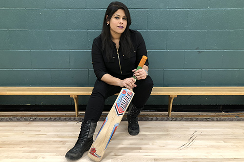 Sanam Iftikhar, holding a cricket bat, is a member of Titans Divas Women's Cricket Team, excited to represent Saskatchewan in the upcoming provincial tournament in Alberta. Photo by Madina Azizi.