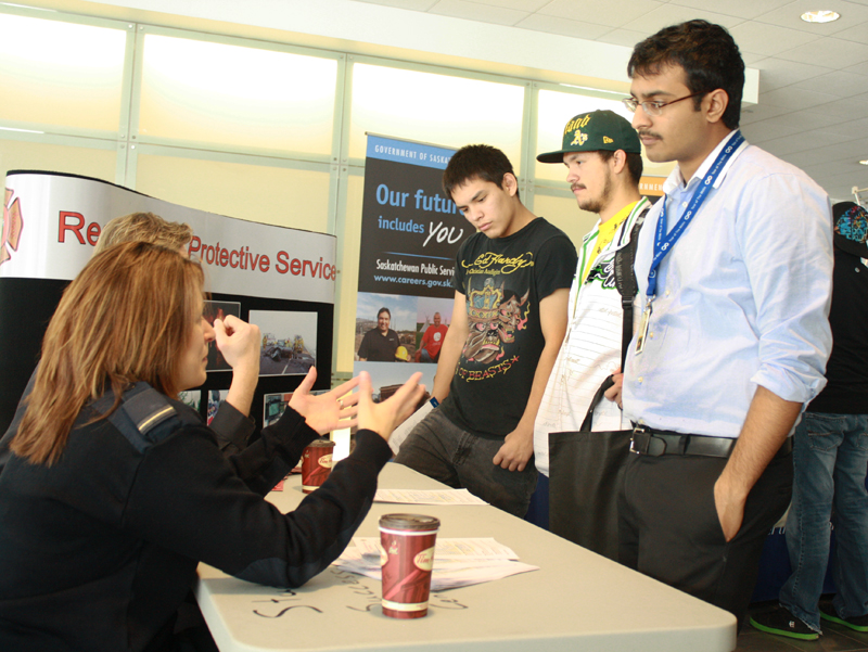 Students at the Aboriginal Career Centre's career day chat with potential employers. Photo by Jamie Fischer.