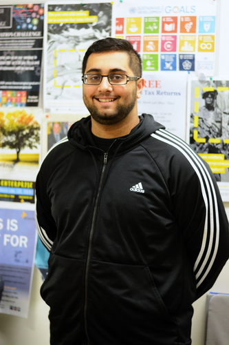 Salmaan Moolla poses in the ENACTUS Club office at the University of Regina Business School. Photo by Heidi Atter.