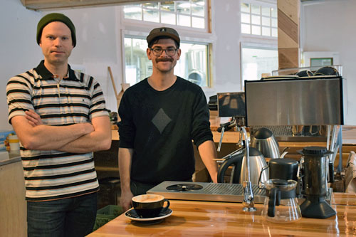 33 ⅓ Coffee Roasters owner Eric Galbraith (left) and barista Ethan Anderson (right) stand behind the coffee bar. Photo by Jessie Anton.