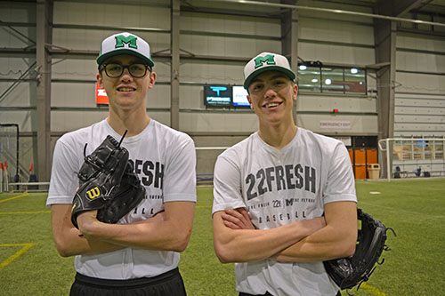 Martin Academy students Eric Applequist (Left) and Kyle Angielski (Right) hang out at Evraz Place before baseball practice. Photo by Alex Johnson.