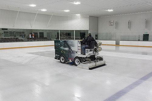 Zamboni resurfacing ice.