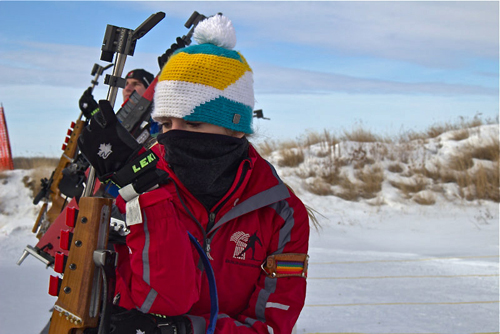 Sydney Notschaele, 15-year-old biathlete on Team Saskatchewan, gets ready to take aim with her rifle during target practice at the Regina Wildlife Federation. Photo by Victoria Dinh.