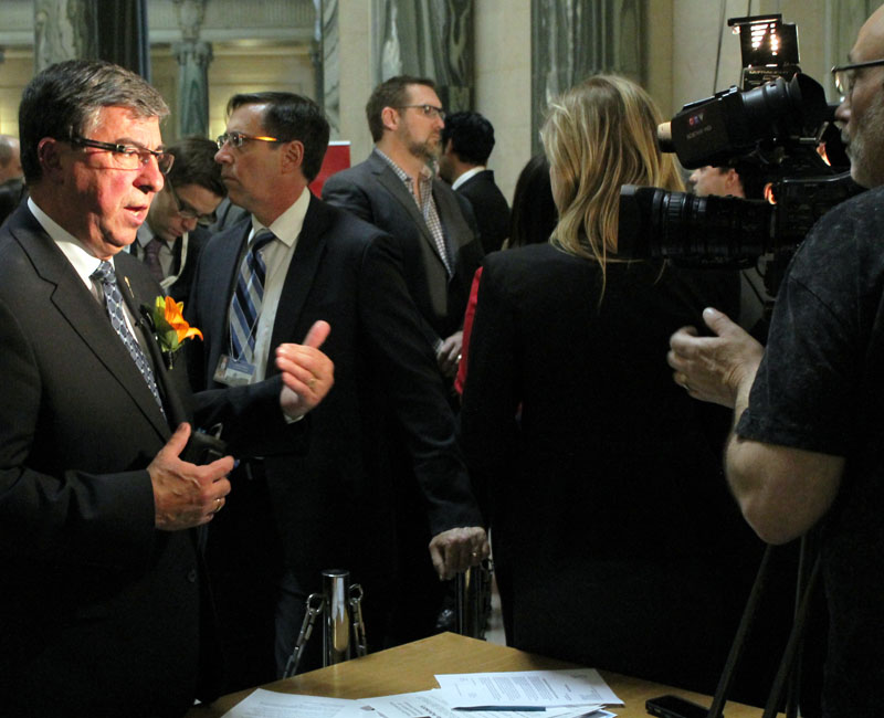 The Sask finance minister, Hon. Ken Krawetz, at the Legislative Building on March 20 after announcing the budget. Photo by Shinoah Young