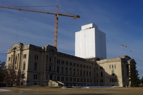 The Saskatchewan Legislature, shown from the outside, with its famous dome under construction.