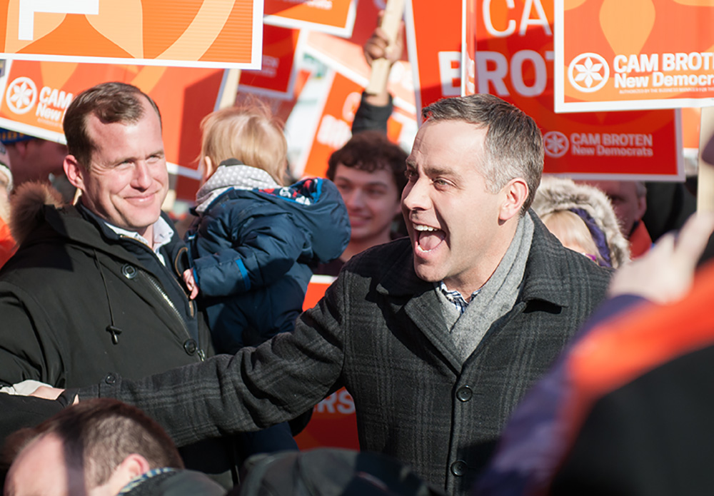 NDP leader Cam Broten greets supporters before the leaders' debate on March 23.