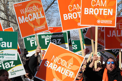 NDP and Sask Party supporters rally outside before the leaders' debate on March 23.