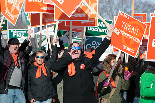 NDP supporters cheer as Cam Broten arrives to the leaders' debate on March 23.