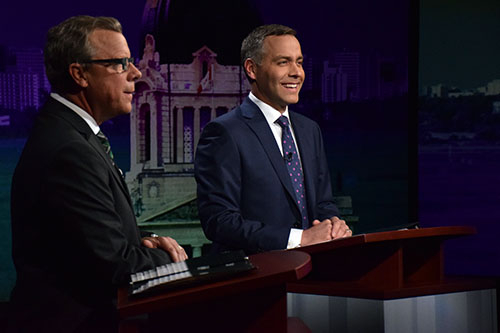 Saskatchewan Party leader Brad Wall (left) and New Democratic Party leader Cam Broten (right) make small-talk before kicking off the 2016 Leaders' Debate with the film tax credit on March 23, 2016. Photo by Jessie Anton.