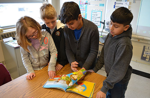 Student's of Mrs. Lara Ewert-Molesky's class at Grant Road School engaged in reading during Agriculture Literacy Week.