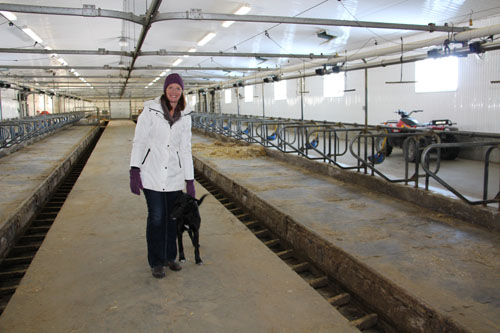 Jennifer Strudwick stands in empty dairy barn.