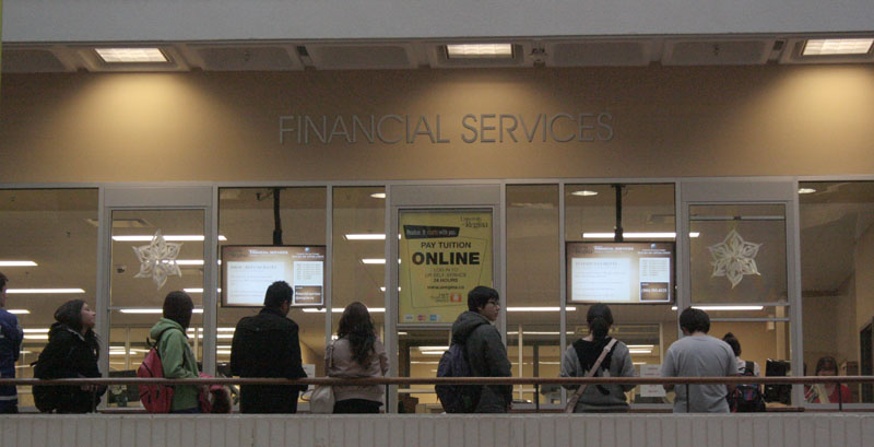 University of Regina students wait in line at financial services