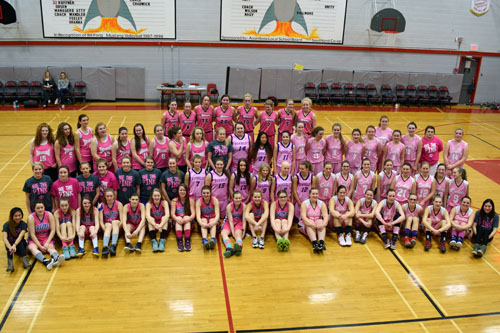 All eight teams participating in the Assiniboia Rockets senior girls' basketball tournament gather in their pink jerseys minutes before the tip-off of Assiniboia's seventh annual Pink Game Feb. 5 at the ACHS gymnasium. Photo by Allison Bamford.