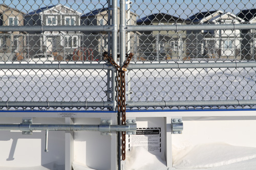 A lock and chain keep the rink doors closed.
